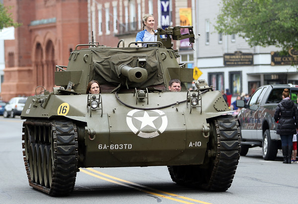DAVID LE/Staff photo. This military tank was a big hit with the crowds lining Cabot Street during the Beverly Memorial Day Parade. 5/30/16.