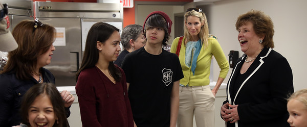 DAVID LE/Staff photo. Beverly Bootstraps Executive Director Sue Gabriel, right, talks with Katie Tilton, and her children, Ali, 17, and Charlie, 14, at the ribbon cutting ceremony for the new Beverly Bootstraps home on Park Street. 5/18/16.