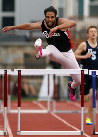 DAVID LE/Staff photo. Salem senior Joel Nunez clears the last hurdle with ease and earns himself a fourth place finish in the boys 400 meter hurdles at the conference meet. 5/21/16.