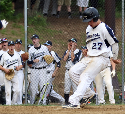 DAVID LE/Staff photo. Peabody junior Nick Palma crosses the plate with the Tanners second run in the first inning on a wild pitch against Bishop Fenwick. 5/30/16.