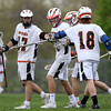 DAVID LE/Staff photo. Ipswich junior captain Charlie Gillis, left, is greeted by his teammates after his second quarter goal against Newburyport. 5/13/16.