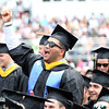 DAVID LE/Staff photo. Endicott College graduate Kevin Caba pumps his fist in the air as he cheers on a classmate as they receive their diploma on Saturday morning. 5/21/16.