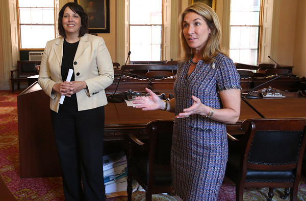 KEN YUSZKUS/Staff photo.          Salem Mayor Kim Driscoll, left, listens to  Lt. Gov. Karyn Polito speak before the signing of the community compact.           05/31/16