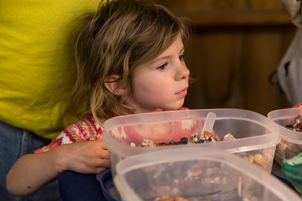 PARKER FISH/ Photo. Four year old Evelyn Faye Morris looks through a container of polished stones. 4/30/16