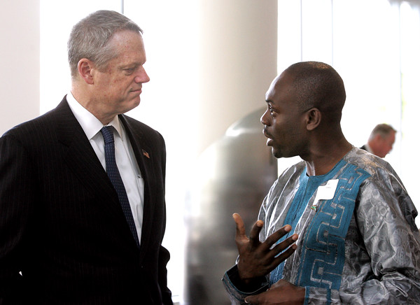 KEN YUSZKUS/Staff photo.     Gov. Charlie Baker, left, talks with Salem State University student Ciro Njinyah when he arrives to speak to the North Shore Alliance for Economic Development at Salem State University Tuesday morning.     05/17/16