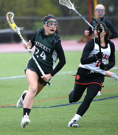 KEN YUSZKUS/Staff photo.     Pentucket's Emily Schultz runs the ball upfield with Beverly's Meghan Smallman at her side during the Pentucket at Beverly girls lacrosse.          05/02/16