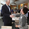KEN YUSZKUS/Staff photo.     Gov. Charlie Baker talks with Salem State University visiting professor Judith Josephs when he arrives to speak to the North Shore Alliance for Economic Development at Salem State University Tuesday morning.     05/17/16