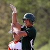 DAVID LE/Staff photo. Manchester-Essex catcher Robbie Sarmanian celebrates his RBI double against Ipswich on Tuesday afternoon. 5/17/16.