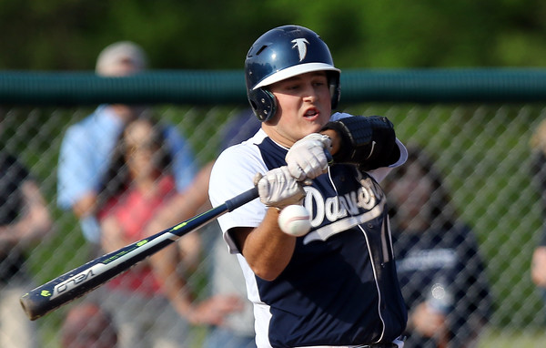 DAVID LE/Staff photo. Danvers sophomore Zach Dillon keeps his eyes on the ball as he lines an RBI single to plate junior Matt Andreas with the eventual game winning run as the Falcons knocked off Beverly 4-3 to capture the NEC title. 5/27/16.