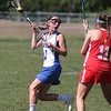 KEN YUSZKUS/Staff photo.          Danvers' Isabel McKenna, left, looks over her shoulder for a teammate to pass to during the Wakefield at Danvers girls lacrosse tournament game.            05/31/16