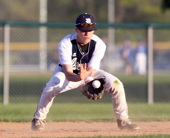 DAVID LE/Staff photo. Danvers shortstop Justin Roberto fields a grounder against Peabody. 5/18/16.
