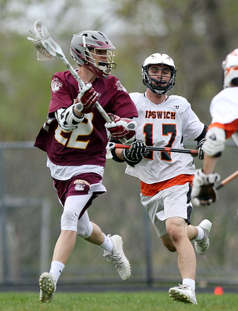 DAVID LE/Staff photo. Newburyport junior attack Cullen Heath looks to make a pass against Ipswich on Friday afternoon. 5/13/16.