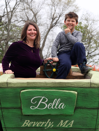 "DAVID LE/Staff photo. Josie Marino, of Beverly, and her seven-year-old son, Jake, proudly stand on a statue with a dedication plaque to her daughter Isabella Rose Marino, who passed away from a rare blood disorder. ""Bella"" had loved the Dane Street Beach playground and for the past two years, Marino has been working to revitalize the playground with new equipment, climbable statues, while incorporating educational materials for all children to enjoy. 5/13/16."