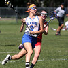 KEN YUSZKUS/Staff photo.          Danvers' Allie Zunick runs the ball downfield during the Wakefield at Danvers girls lacrosse tournament game.            05/31/16
