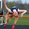 KEN YUSZKUS/Staff photo.    Hamilton-Wenham's Rose Wosepka attempts going over the bar at the track meet at Ipswich High School.     05/04/16