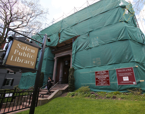 KEN YUSZKUS/Staff photo.    The Salem Public Library is shrouded and hides the workers and scaffolding.       05/09/16