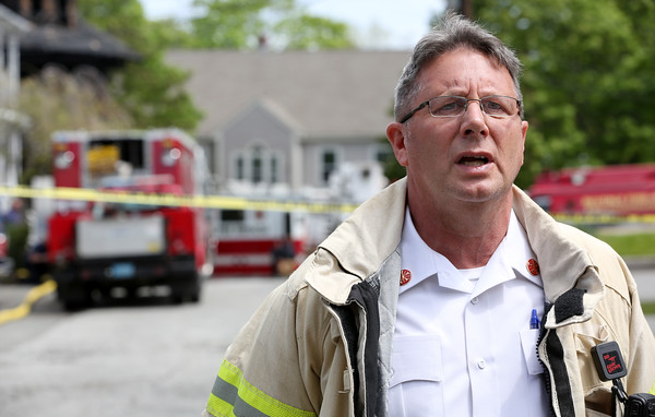 KEN YUSZKUS/Staff photo.      Beverly Fire Chief Paul Cotter speaks at the press conference at the scene of the fatal fire at 9 Highland Terrace in Beverly.    05/19/16
