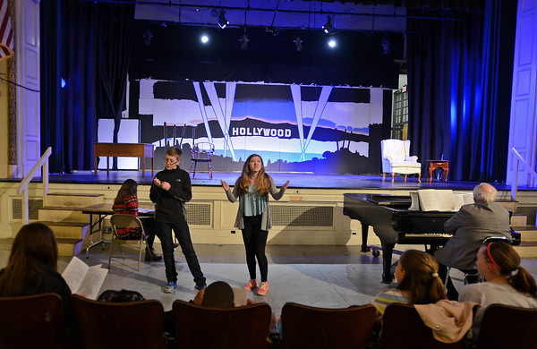 """RYAN HUTTON/Staff photo<br /> From left, Briscoe Middle School students Connor Hathaway and Liliana Bauman rehearse """"Lucy Dollar, Private Eye: The Musical"""" on Tuesday afternoon."""