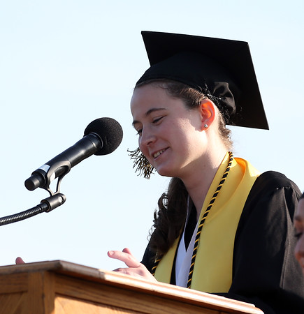 DAVID LE/Staff photo. Bishop Fenwick Salutatorian Olivia Comeau delivers her address on Friday evening. 5/20/16.