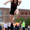 DAVID LE/Staff photo. Marblehead sophomore Sarah Caulfield leaps high and extends her body during one of her final jumps in the triple jump on Saturday. Caulfield took home a second place finish in the triple jump at the NEC Conference Meet. 5/21/16.