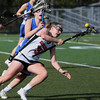 KEN YUSZKUS/Staff photo.   Marblehead's Lucie Poulin goes down with ball  during the Danvers at Marblehead girls lacrosse game at Marblehead High School.     05/16/16