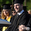 DAVID LE/Staff photo. Bishop Fenwick graduate Michael Gallant listens with a smile to Senior Class President Melissa MacKenzie during her welcome address on Friday evening. 5/20/16.