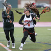 KEN YUSZKUS/Staff photo.     Pentucket's Ciara O'Neil tries to block Beverly's Sabrina Beaudry during the Pentucket at Beverly girls lacrosse.          05/02/16