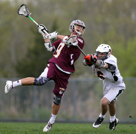 DAVID LE/Staff photo. Newburyport senior captain Will Fogel winds up for a shot while being defended Ipswich sophomore Blake Emerson (6). 5/13/16.