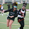 KEN YUSZKUS/Staff photo.     Pentucket's Hannah Goodwin is knocked off balance as Beverly's Amanda Rosenberger and her go after the loose ball during the Pentucket at Beverly girls lacrosse.          05/02/16