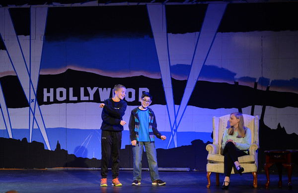 """RYAN HUTTON/Staff photo<br /> From left, Briscoe Middle School students Charlie Barrior, Adam Harrison, and Abby Bettencourt rehearse """"Lucy Dollar, Private Eye: The Musical"""" on Tuesday afternoon."""