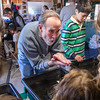 PARKER FISH/ Photo. Dick Currier of Beverly, teaches a group of children how to pan for gold flakes during the Annual New England Gem and Mineral Show. 4/30/16