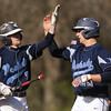 PAUL BILODEAU/Staff photo. Jake Doherty, right, high-fives teammate Jon Lawrence after Lawrence got him in on an RBI during Magicians' game against the Tanners at Seaside Park in Marblehead.
