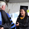DAVID LE/Staff photo. Peabody resident and 2016 Endicott College graduate Samantha DiBella smiles while receiving her diploma from President Dr. Richard Wylie on Saturday morning. 5/21/16.