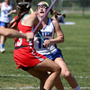 KEN YUSZKUS/Staff photo.         A Wakefield player blocks Danvers' Olivia Heutlinger during the Wakefield at Danvers girls lacrosse tournament game.            05/31/16