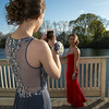 Photo/Reba Saldanha  Kelsey Black takes a photo of Ashley Fischer at the library's Rotary Pavilion before boarding buses to the Danvers High School junior prom Friday April 29, 2016