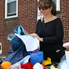 DAVID LE/Staff photo. Orebes Deases, of Peabody, looks through a few toys and games at the third annual yard sale hosted by Citizens for Adequate Housing on Saturday morning. 5/14/16.