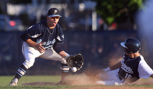 DAVID LE/Staff photo. Peabody shortstop Jake Gustin is handcuffed by a throw to second as Danvers senior Ryan McGinnis slides safely into second on a steal. 5/18/16.
