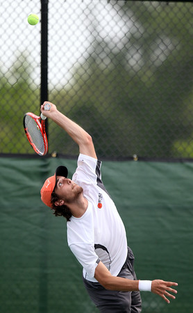 DAVID LE/Staff photo. Beverly senior and first singles player Peter Colletti earned a win over Marblehead's Justin Faia and help the Panthers to a 3-2 win over the Magicians. 5/26/16.