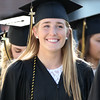 DAVID LE/Staff photo. Bishop Fenwick graduate Merry Harrington flashes a wide smile while marching into graduation on Friday evening. 5/20/16.