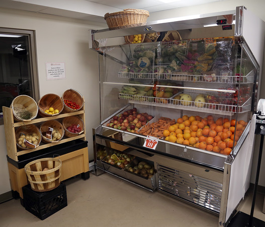 DAVID LE/Staff photo. A new produce cooler in the self-serve pantry at the new Beverly Bootstraps home on Park Street. 5/18/16.