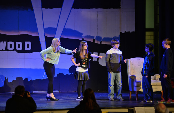 "RYAN HUTTON/Staff photo<br /> From left, Briscoe Middle School students Abby Bettencourt, Olivia Arenburg, Owen LaBrie, Adam Harrison and Charlie Barrior rehearse ""Lucy Dollar, Private Eye: The Musical"" on Tuesday afternoon."