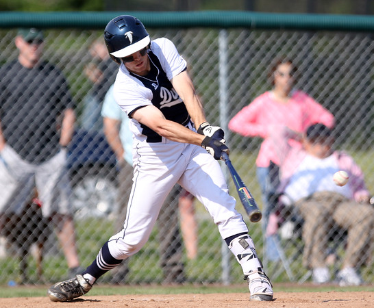DAVID LE/Staff photo. Danvers senior Tim Unczur lines a seeing-eye single through the middle to plate the Falcons' first run of the game against Beverly. 5/27/16.