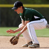 DAVID LE/Staff photo. Manchester-Essex second baseman Jack Julien fields a grounder and throws out an Ipswich runner. 5/17/16.