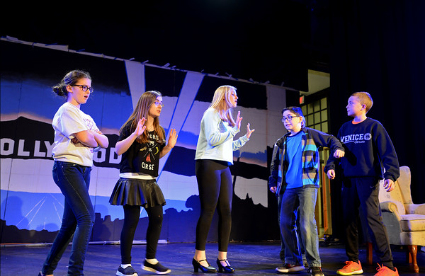 """RYAN HUTTON/Staff photo<br /> From left, Briscoe Middle School students Olivia Doherty, Olivia Arenburg, Abby Bettencourt, Adam Harrison and Charlie Barrior rehearse """"Lucy Dollar, Private Eye: The Musical"""" on Tuesday afternoon."""