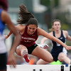 DAVID LE/Staff photo. Gloucester sophomore Kaitlin Marques leaps over a hurdle during the qualifying heat of the 100 meter high hurdles. Marques placed 4th overall at the NEC Conference Meet. 5/21/16.