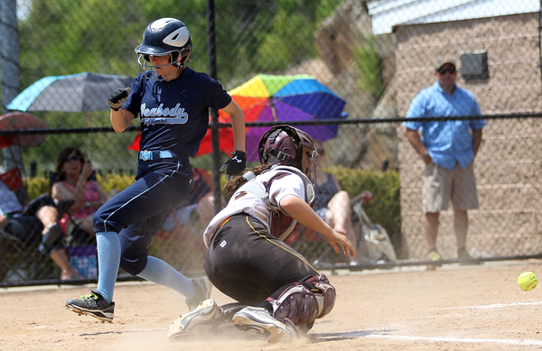 DAVID LE/Staff photo. Peabody sophomore Kelsie Blake scampers across the plate as the ball bounces away from Bishop Fenwick catcher Tessa Palermo. 5/28/16.