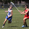 KEN YUSZKUS/Staff photo.          Danvers' Morgan Mscisz, left, runs up against a Wakefield player during the Wakefield at Danvers girls lacrosse tournament game.            05/31/16