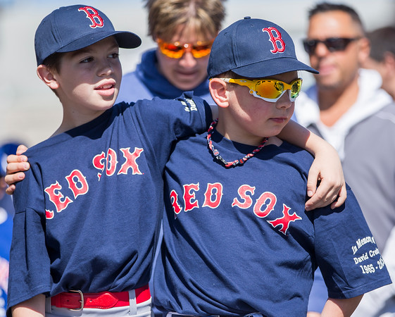 PARKER FISH/ Photo. Brayden Holt (left) and Luke Bowden (right) put their arms around each other during the Danvers Little League opening day parade. 4/30/16