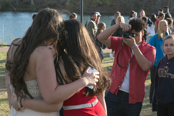 Photo/Reba Saldanha  Jolssen Rodriguez takes a photo of friends at the library's Rotary Pavilion before boarding buses to the Danvers High School junior prom Friday April 29, 2016