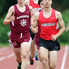 DAVID LE/Staff photo. Marblehead's Ian Struthers, right, runs shoulder to shoulder with Gloucester's Charlie Davis, left. 5/24/16.